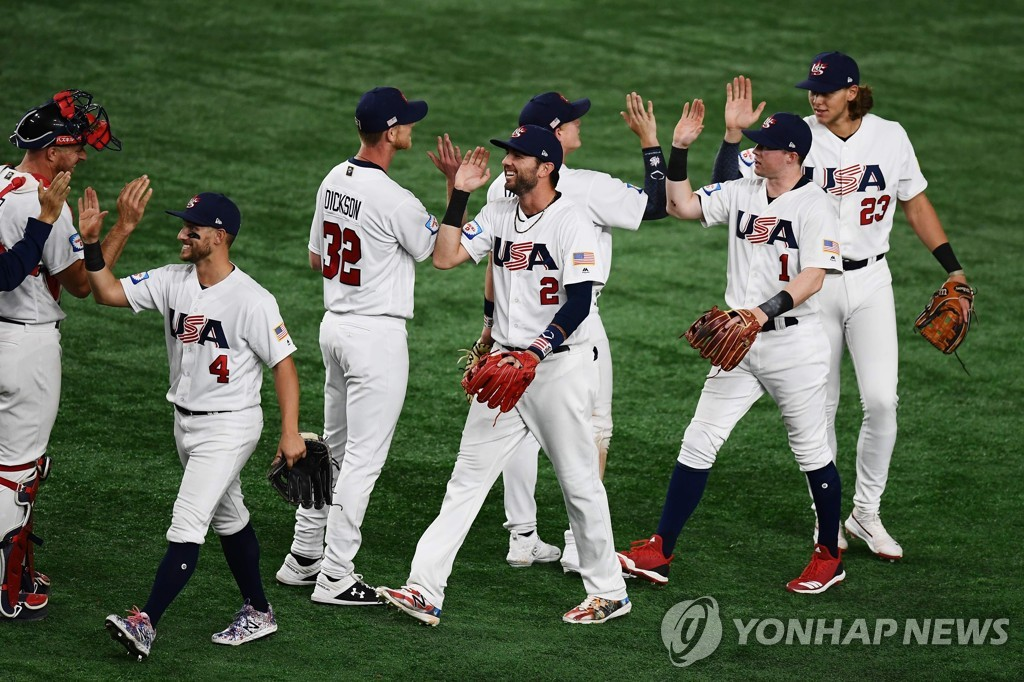 In this AFP photo, players of the United States celebrate their 3-2 victory over Chinese Taipei in the Super Round at the World Baseball Softball Confederation (WBSC) Premier12 at Tokyo Dome in Tokyo on Nov. 15, 2019. (Yonhap)