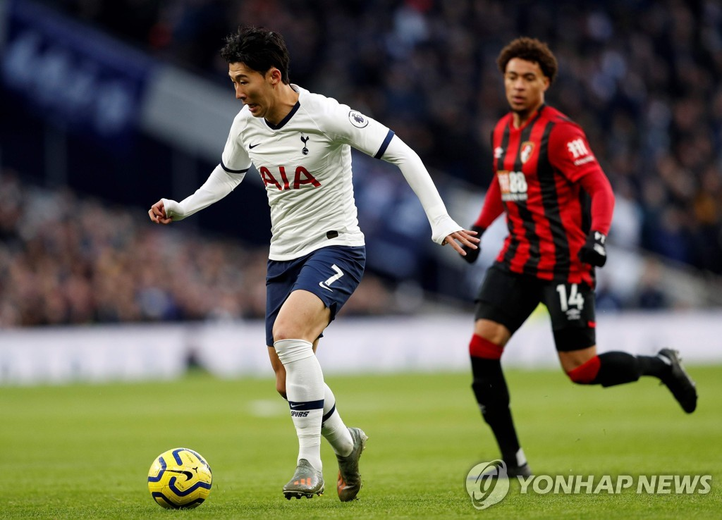 In this AFP photo, Son Heung-min of Tottenham Hotspur (L) controls the ball during a Premier League match against Bournemouth at Tottenham Hotspur Stadium in London, on Nov. 30, 2019. (Yonhap)