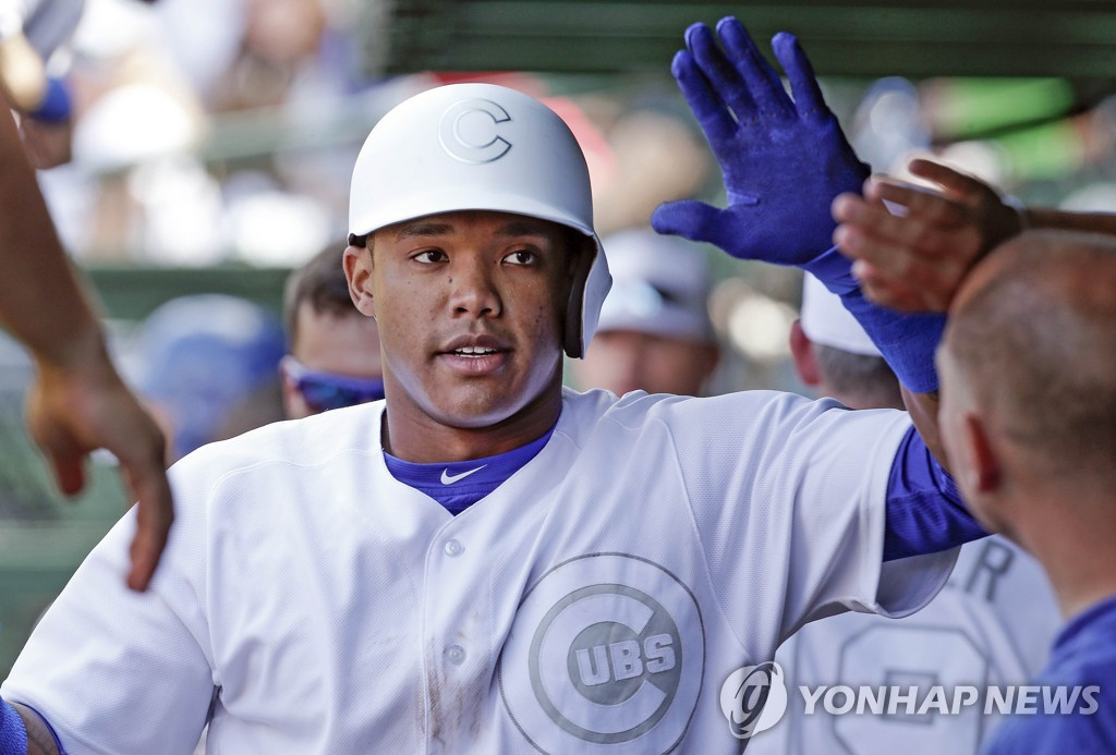 In this Getty Images file photo from Aug. 24, 2019, Addison Russell of the Chicago Cubs celebrates his home run during the bottom of the fifth inning of a Major League Baseball regular season game against the Washington Nationals at Wrigley Field in Chicago. (Yonhap)