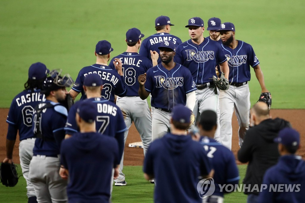In this Getty Images photo, members of the Tampa Bay Rays celebrate their 5-2 victory over the Houston Astros in Game 3 of the American League Championship Series at Petco Park in San Diego on Oct. 13, 2020. (Yonhap)