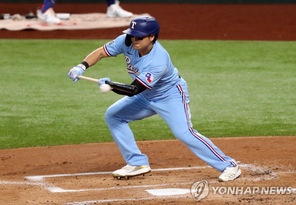 In this USA Today Sports photo via Reuters, Choo Shin-soo of the Texas Rangers bunts for a single against the Houston Astros during the bottom of the first inning of a Major League Baseball regular season game at Globe Life Field in Arlington, Texas, on Sept. 27, 2020. (Yonhap)