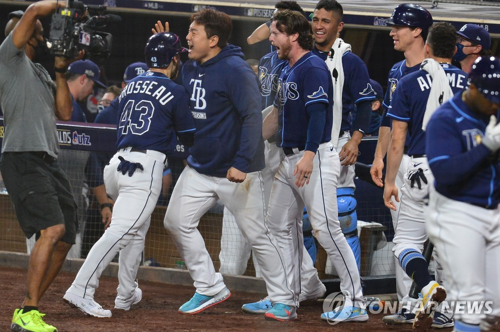 In this USA Today Sports photo via Reuters, Choi Ji-man of the Tampa Bay Rays (C) greets teammate Mike Brosseau after Brosseau's solo home run against the New York Yankees in the bottom of the eighth inning of Game 5 of the American League Division Series at Petco Park in San Diego on Oct. 9, 2020. (Yonhap)