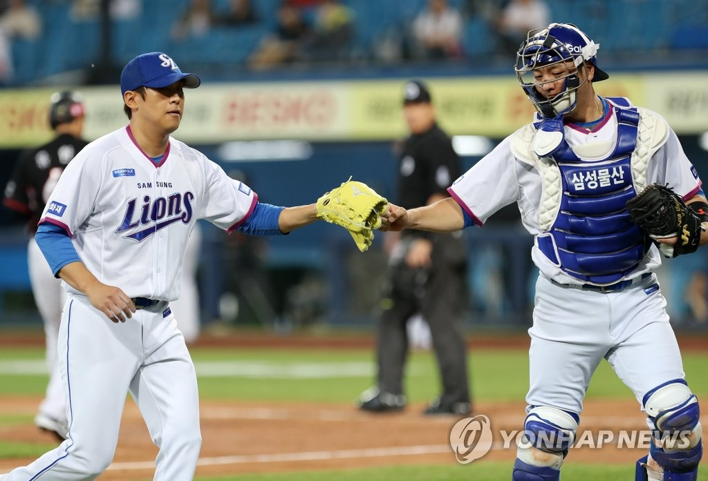 In this file photo from April 20, 2019, Yun Sung-hwan (L) and Kang Min-ho of the Samsung Lions celebrates getting out of a bases-loaded jam against the KT Wiz in the top of the fourth inning of a Korea Baseball Organization regular season game at Daegu Samsung Lions Park in Daegu, 300 kilometers southeast of Seoul. (Yonhap)