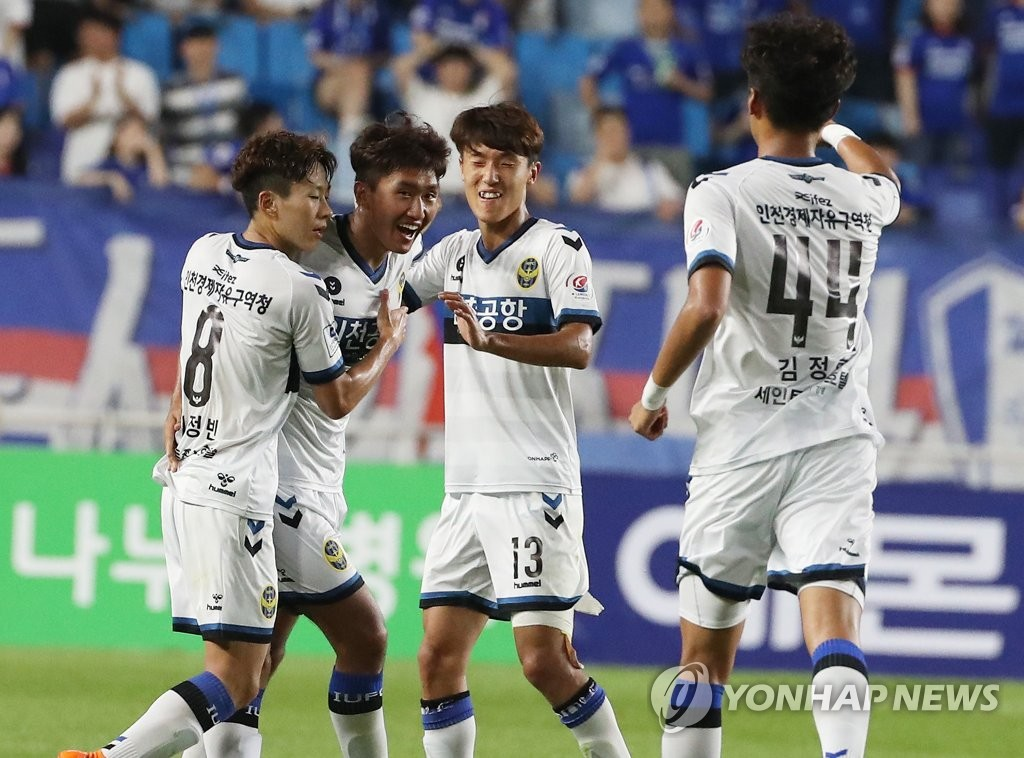 In this file photo taken on July 18, 2018, Incheon United players celebrate after scoring a goal against Suwon Samsung Bluewings in a K League 1 match at Suwon World Cup Stadium in Suwon, south of Seoul. (Yonhap)