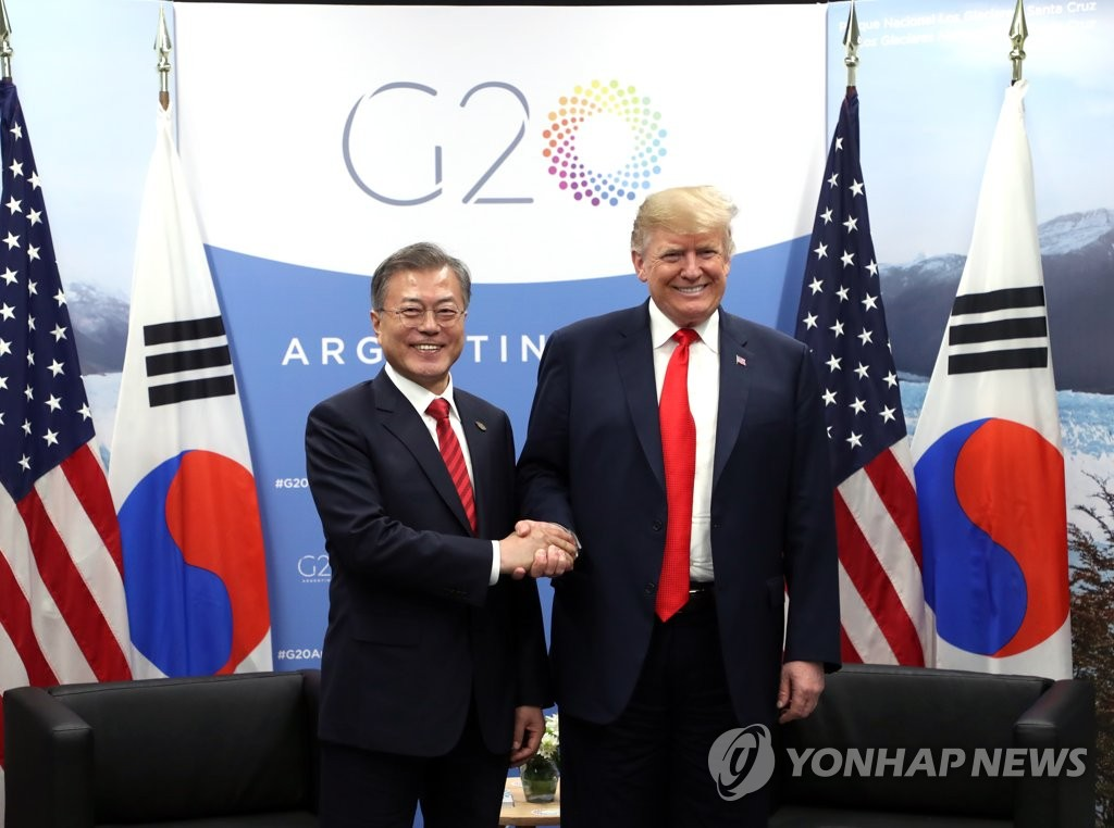 South Korean President Moon Jae-in (L) and U.S. President Donald Trump shake hands before holding a bilateral meeting on the sidelines of the Group of 20 Leaders' Summit in Buenos Aires on Nov. 30, 2018. (Yonhap)