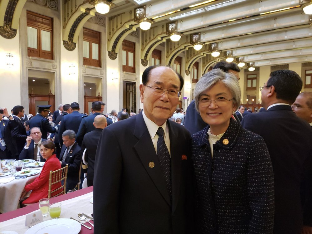 In this photo, provided by Seoul's foreign ministry, South Korean Foreign Minister Kang Kyung-wha (R) poses for a photo with North Korea's ceremonial head of state, Kim Yong-nam, in Mexico. The ministry said they met on Dec. 1, 2018, during a luncheon held on the sidelines of the presidential inauguration ceremony of Andres Manuel Lopez Obrador. (Yonhap)