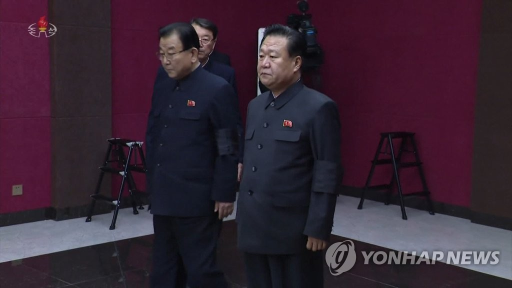 This photo, captured from North Korean TV, shows Choe Ryong-hae (R), vice chairman of the ruling Workers' Party. (For Use Only in the Republic of Korea. No Redistribution.) (Yonhap)