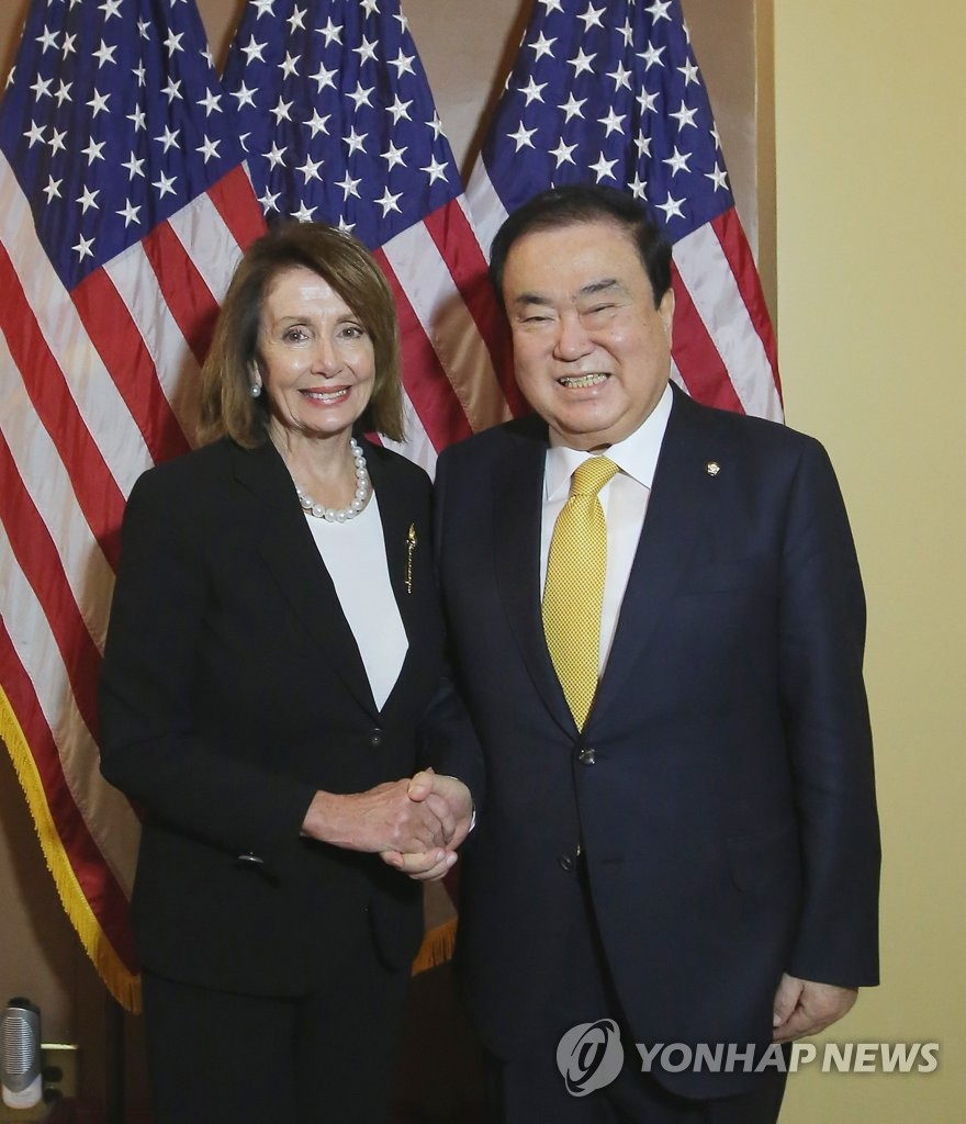 National Assembly Speaker Moon Hee-sang (R) shakes hands with Nancy Pelosi, the speaker of the U.S. House of Representatives, on Feb. 13, 2019 in the Capitol building in Washington D.C. during his visit to the U.S. (Yonhap)