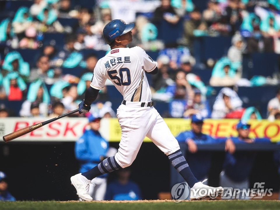 In this March 23, 2019, photo provided by the NC Dinos, Christian Bethancourt watches his three-run home run against the Samsung Lions in the bottom of the first inning of a Korea Baseball Organization regular season game at Changwon NC Park in Changwon, 400 kilometers southeast of Seoul. (Yonhap)