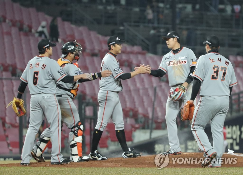 In this file photo from March 26, 2019, players of the Hanwha Eagles celebrate their 13-7 victory over the Kia Tigers in a Korea Baseball Organization regular season game at Gwangju-Kia Champions Field in Gwangju, 330 kilometers south of Seoul. (Yonhap)