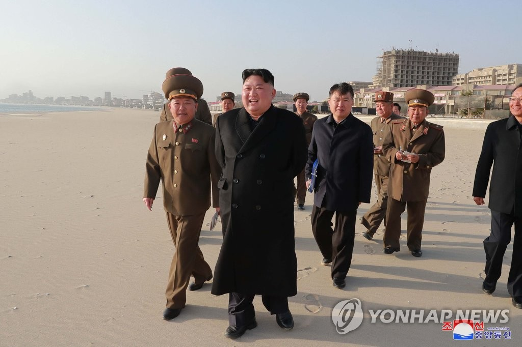 This photo, carried by North Korea's state news agency on April 6, 2019, shows its leader Kim Jong-un (C) inspecting the Wonsan-Kalma coastal tourist area. (For Use Only in the Republic of Korea. No Redistribution) (Yonhap)