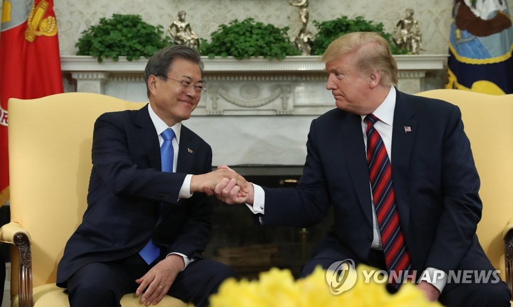 South Korean President Moon Jae-in (L) and U.S. President Donald Trump shake hands before the start of their meeting at the White House in Washington on April 11, 2019. (Yonhap)