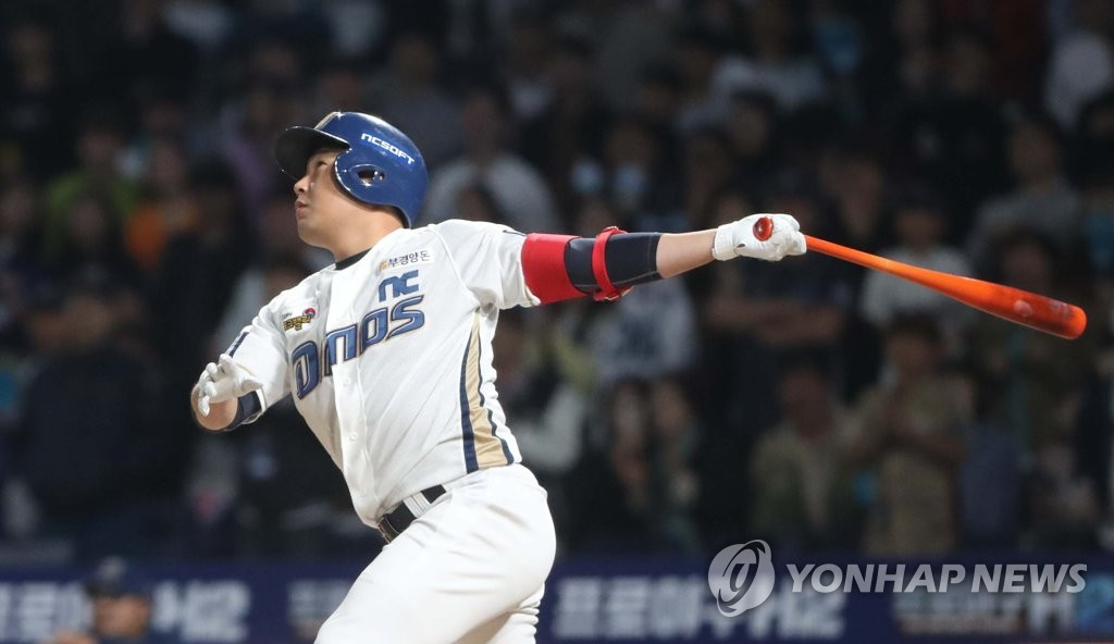 In this file photo from April 18, 2019, Yang Eui-ji of the NC Dinos follows the flight of his batted ball against the LG Twins in the bottom of the sixth inning of a Korea Baseball Organization regular season game at Changwon NC Park in Changwon, 400 kilometers southeast of Seoul. (Yonhap)