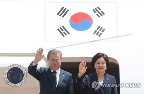 Moon back in Korea after Northern Europe trip