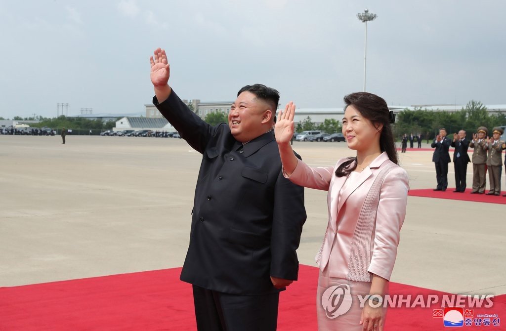 North Korean leader Kim Jong-un and his wife, Ri Sol-ju, wave at Pyongyang's Sunan International Airport in this Korean Central News Agency photo as Chinese President Xi Jinping heads home after a visit to North Korea on June 21, 2019. (For Use Only in the Republic of Korea. No Redistribution) (Yonhap)