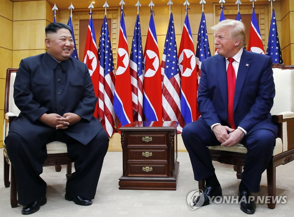 U.S. President Donald Trump (R) talks with North Korean leader Kim Jong-un as they meet at the Freedom House on the southern side of the truce village of Panmunjom in the Demilitarized Zone, which separates the two Koreas, on June 30, 2019. (Yonhap)