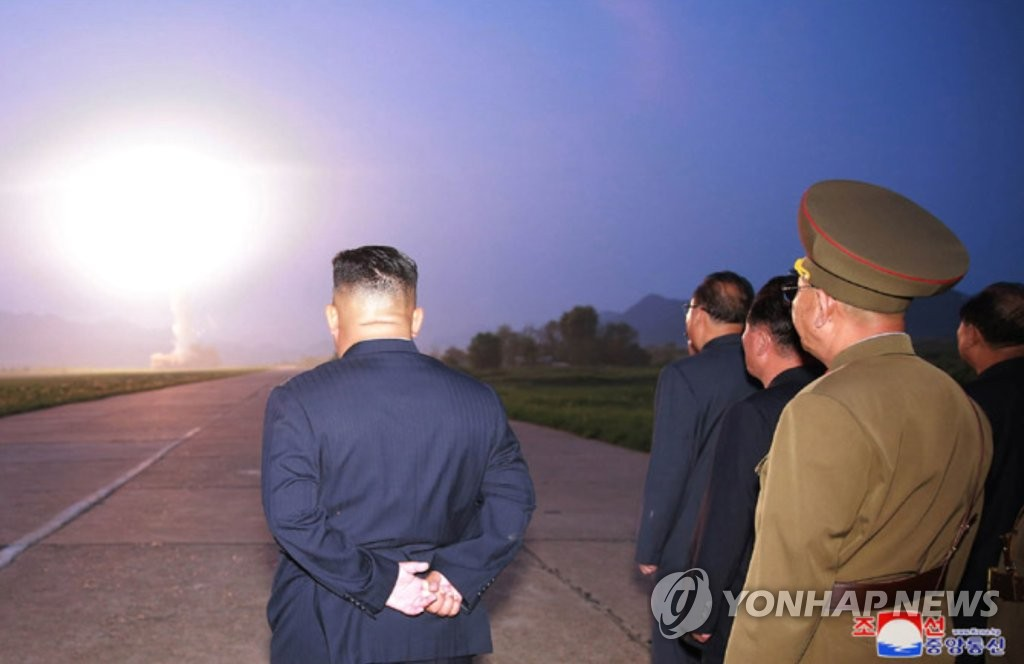 North Korean leader Kim Jong-un (L) watches the launch of a new tactical guided missile on Aug. 6, 2019, in this photo released by the Korean Central News Agency the next day. North Korea fired two projectiles believed to be short-range ballistic missiles into the East Sea on Aug. 6, the fourth such launch in less than two weeks. (For Use Only in the Republic of Korea. No Redistribution) (Yonhap)