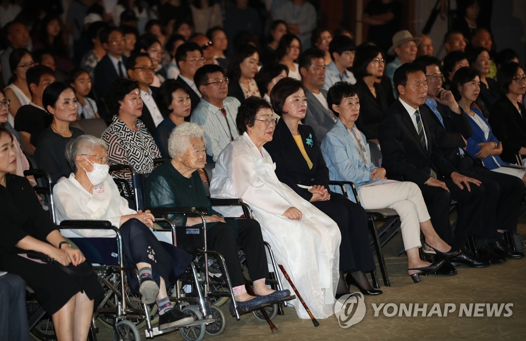 Victims of Japan's wartime sex slavery participate in the government-led ceremony to commemorate International Memorial Day for Comfort Women at the Kim Koo Museum and Library in central Seoul on Aug. 14, 2019. (Yonhap)