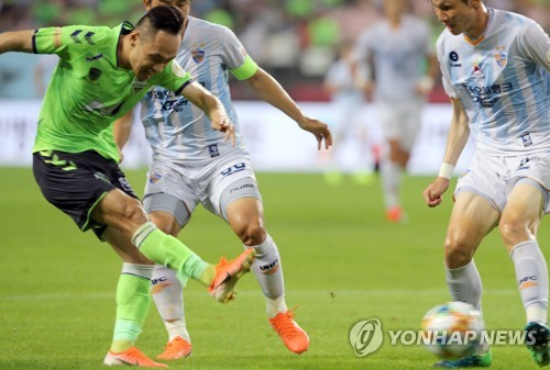 Jeonbuk forward kicks ball