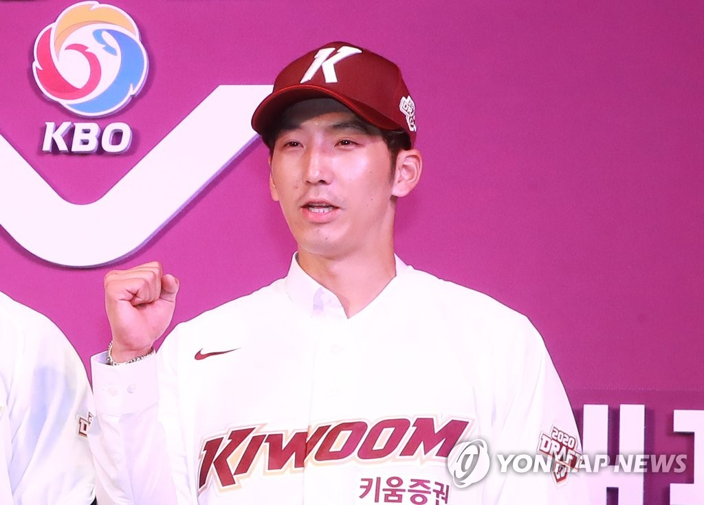 Infielder Moon Chan-jong poses for photos after being selected 57th overall by the Kiwoom Heroes in the Korea Baseball Organization draft in Seoul on Aug. 26, 2019. (Yonhap)