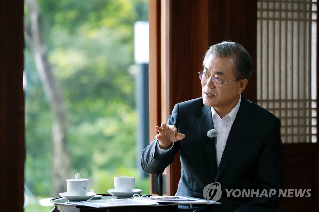 This file photo, provided by Cheong Wa Dae, shows President Moon Jae-in speaking during a media interview at the Sangchunjae pavilion inside the presidential compound. (PHOTO NOT FOR SALE) (Yonhap)