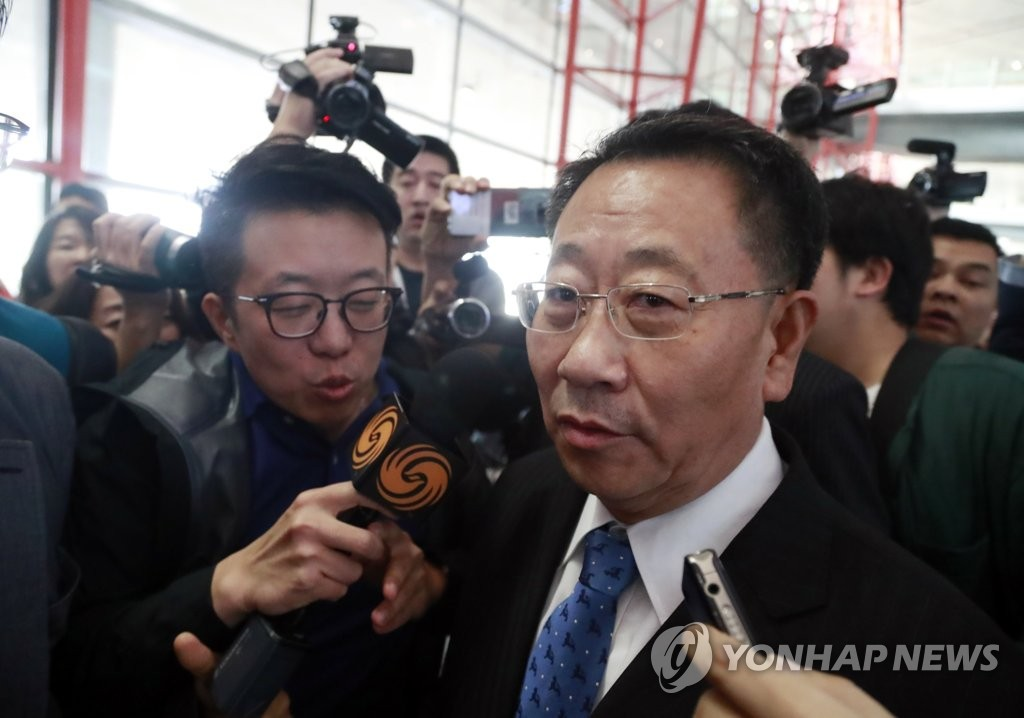 This file photo taken on Oct. 7, 2019, shows Kim Myong-gil (R), North Korea's top nuclear negotiator, arriving in Beijing en route to Pyongyang after working-level talks with U.S. officials in Stockholm on Oct. 5. (Yonhap)