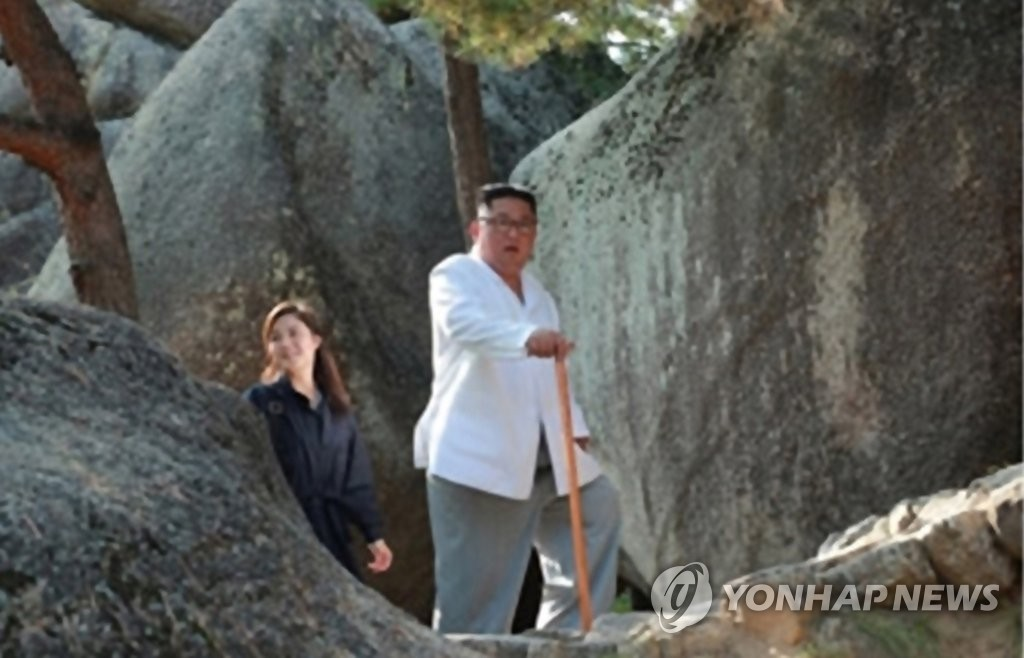 This photo released by the Korean Central News Agency on Oct. 23, 2019 shows Ri Sol-ju (L) following her husband, North Korean leader Kim Jong-un, on his trip to Mount Kumgang on the country's east coast. (For Use Only in the Republic of Korea. No Redistribution) (Yonhap)