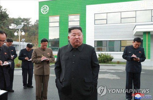 N.K. leader tours factory construction site
