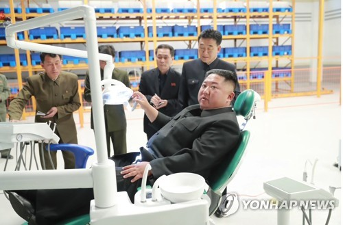 N.K. leader tours factory