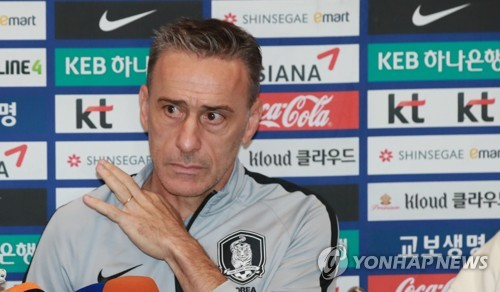 S. Korea football coach defends style of play