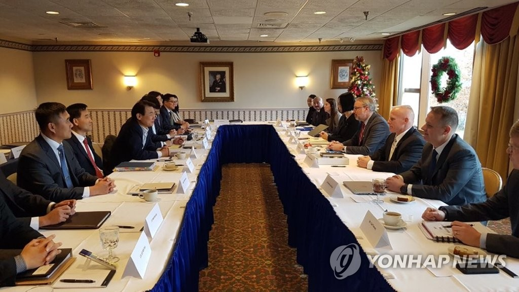 This photo, provided by the South Korean Embassy in Washington, shows negotiators from South Korea and the United States holding a fourth round of talks on renewing the countries' Special Measures Agreement on sharing their defense costs in the U.S. capital on Dec. 4, 2019. (Yonhap)