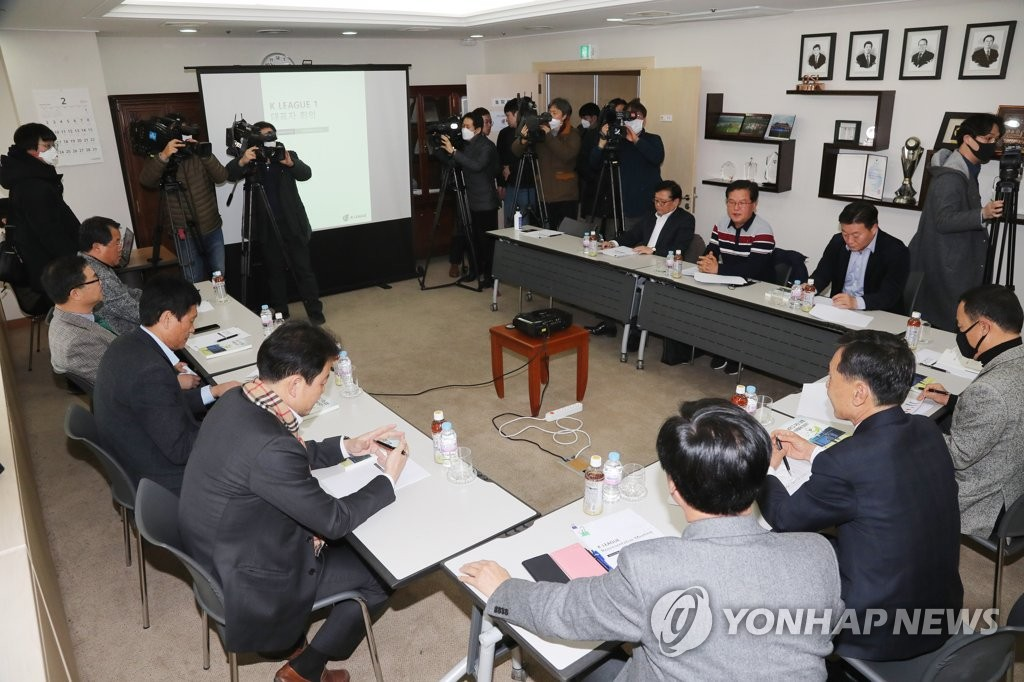 In this file photo from Feb. 21, 2020, Korea Professional Football League officials and representatives from the 12 clubs in the top-flight K League 1 attend a meeting at the league headquarters in Seoul to discuss fixture changes in response to a surge in COVID-19 cases in Daegu and North Gyeongsang Province in the southeastern part of the country. (Yonhap)