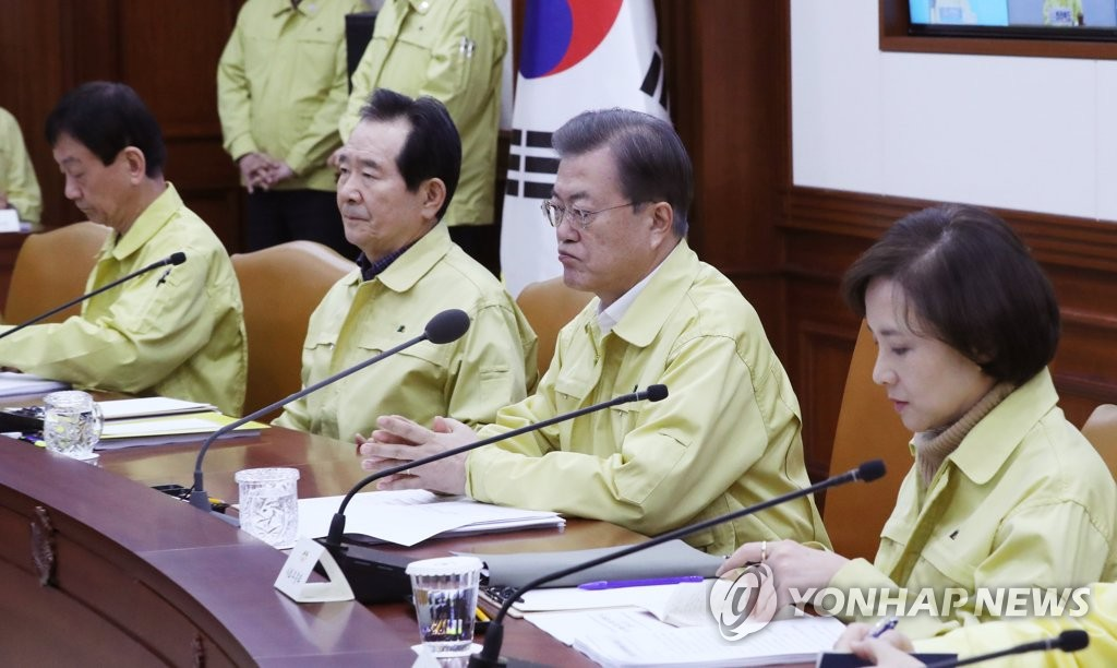 President Moon Jae-in (2nd from R) attends an inter-agency meeting on the coronavirus response at the government complex in Seoul on Feb. 23, 2020. (Yonhap)