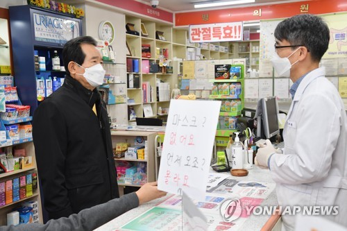 PM checks on masks at drugstore