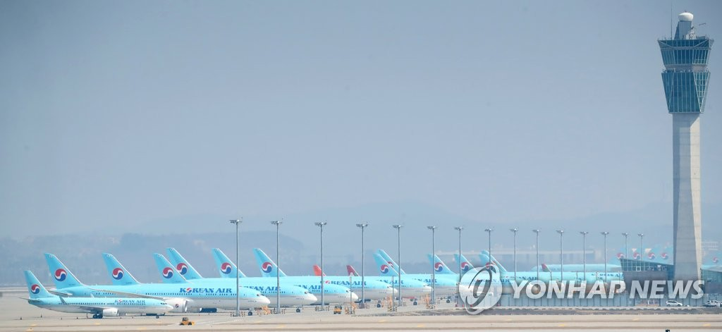 This photo taken on March 24, 2020, shows Korean Air planes parked at Incheon International Airport in Incheon, west of Seoul, amid the spreading coronavirus outbreak. (Yonhap)