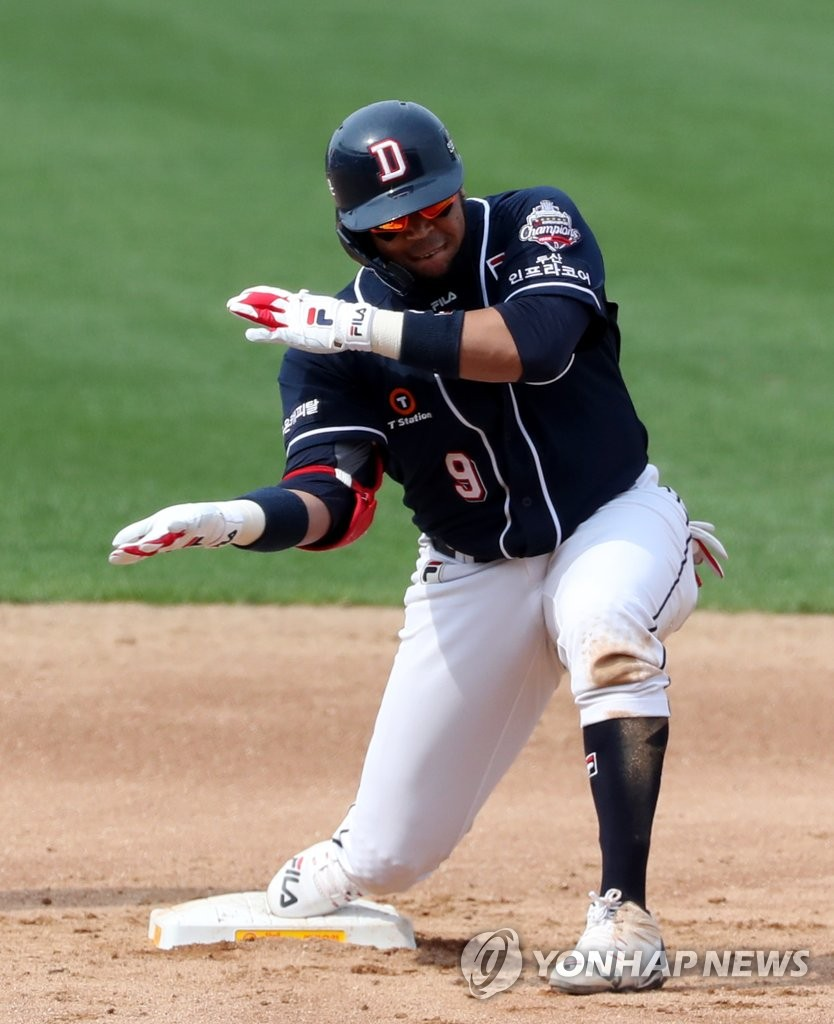 In this file photo from May 17, 2020, Jose Miguel Fernandez of the Doosan Bears celebrates his double with a chopping motion during a Korea Baseball Organization regular season game against the Kia Tigers at Gwangju-Kia Champions Field in Gwangju, 330 kilometers south of Seoul. (Yonhap)