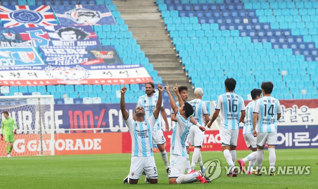 In this file photo from May 17, 2020, Ulsan Hyundai FC players celebrate their goal against Suwon Samsung Bluewings during the teams' K League 1 match at an empty Suwon World Cup Stadium in Suwon, 45 kilometers south of Seoul. (Yonhap)