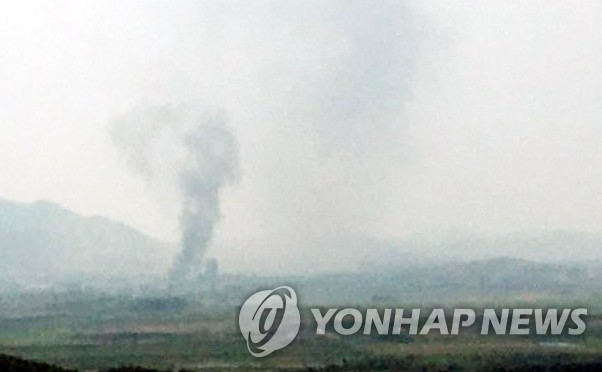 This photo provided by a reader shows smoke rising from North Korea's border city of Kaesong. (Yonhap)