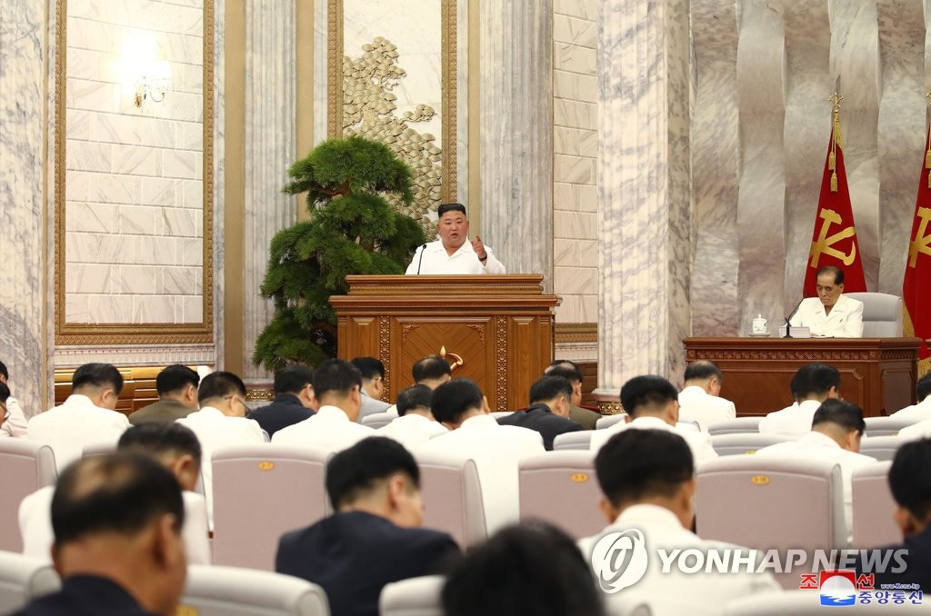 "North Korean leader Kim Jong-un (C, back) presides over a politburo meeting of the ruling Workers' Party at the headquarters of the party's Central Committee in Pyongyang on July 2, 2020, in this photo released by the North's official Korean Central News Agency on July 3. Kim called for ""maximum alert"" against the new coronavirus, warning that premature easing of anti-virus measures will lead to an ""unimaginable and irretrievable crisis,"" according to the agency. (For Use Only in the Republic of Korea. No Redistribution) (Yonhap)"