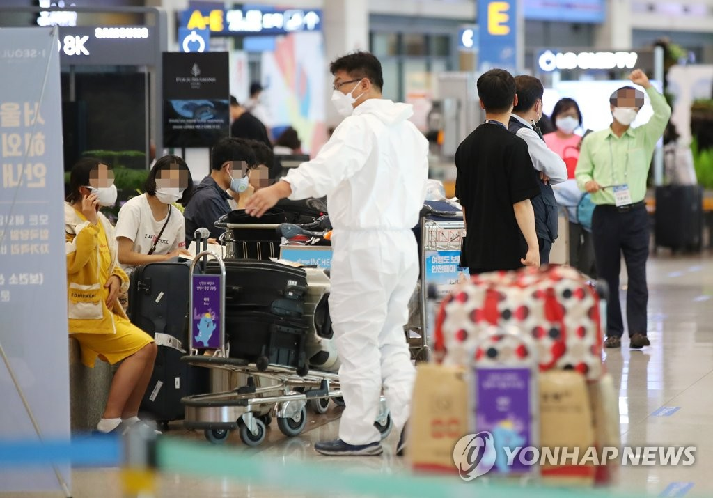 People wait at Incheon International Airport, west of Seoul, on July 31, 2020. (Yonhap)