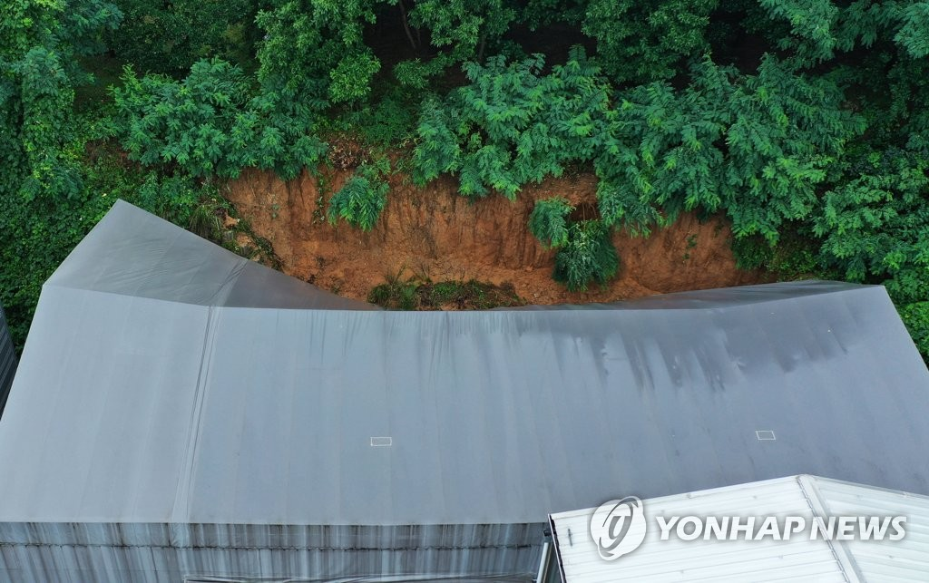 This photo shows a semiconductor parts factory in Pyeongtaek, Gyeonggi Province, where three workers died and one was seriously injured due to a mudslide triggered by torrential rain on Aug. 3, 2020. (Yonhap)