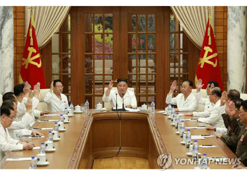North Korean leader Kim Jong-un presides over an enlarged politburo meeting of the Workers' Party to discuss measures to minimize damage from an approaching powerful typhoon and its ongoing anti-epidemic efforts, in this photo released by the Rodong Sinmun, the official newspaper of the ruling party, on Aug. 26, 2020. (For Use Only in the Republic of Korea. No Redistribution) (Yonhap)