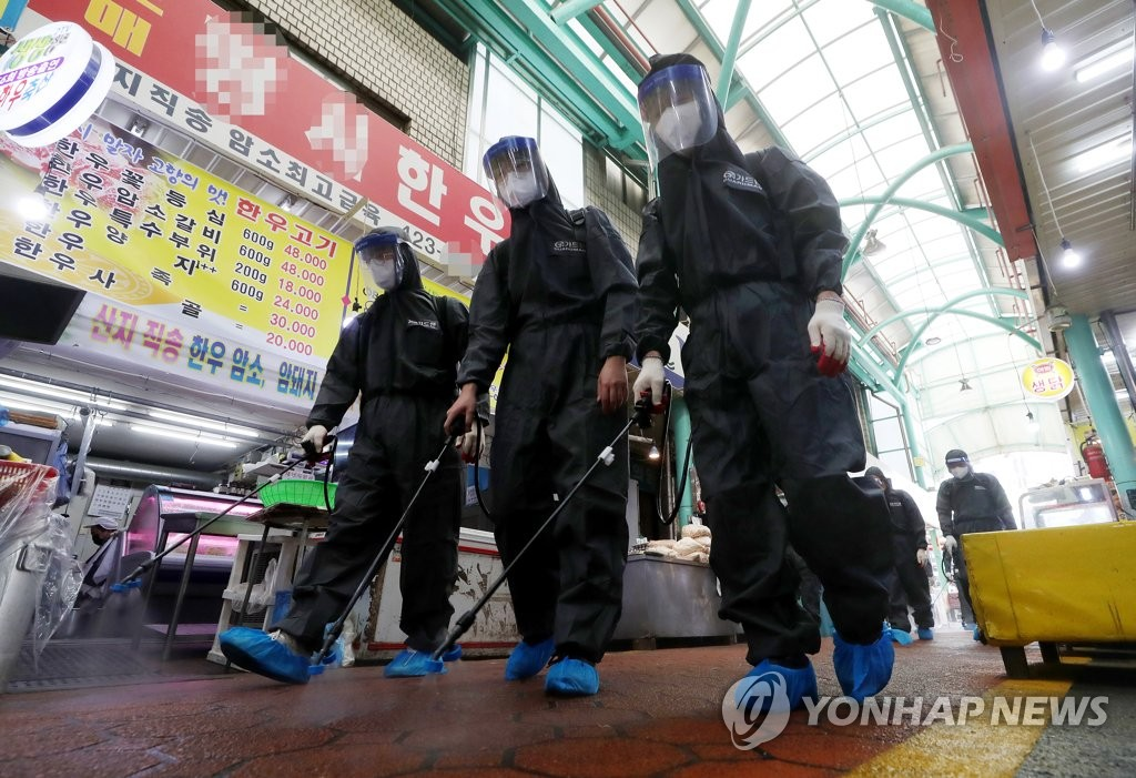 Health workers disinfect a traditional market in Incheon, west of Seoul, ahead of the upcoming Chuseok holiday on Sept. 15, 2020. (Yonhap)