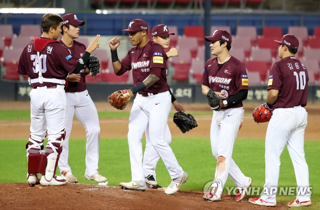 In this file photo from Sept. 23, 2020, members of the Kiwoom Heroes celebrate their 13-1 victory over the Kia Tigers in a Korea Baseball Organization regular season game at Gwangju-Kia Champions Field in Gwangju, 330 kilometers south of Seoul. (Yonhap)
