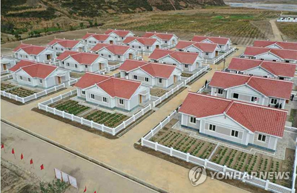 This undated photo, disclosed by the Rodong Sinmun, North Korea's official newspaper, on Oct. 15, 2020, shows a village rebuilt in South Hamgyong Province that was hit by recent back-to-back typhoons. (For Use Only in the Republic of Korea. No Redistribution) (Yonhap)