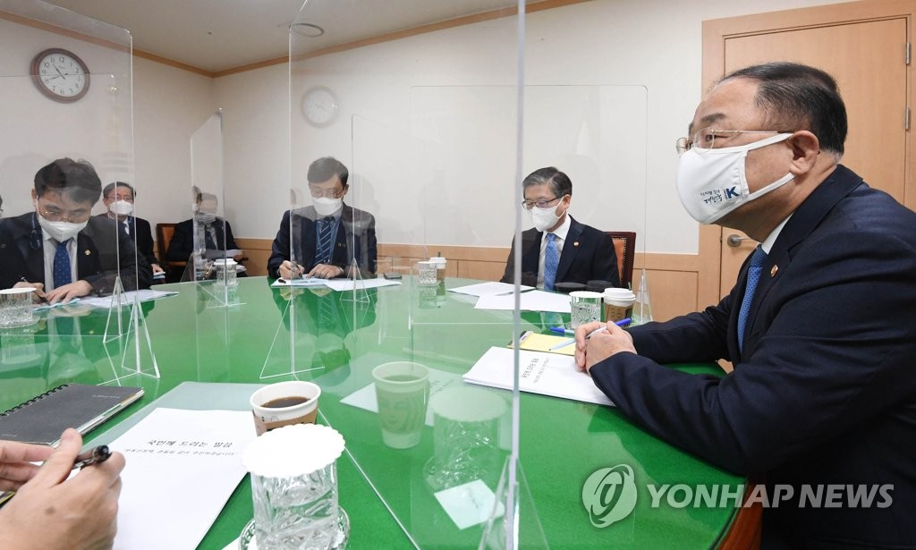 This photo taken on March 7, 2021, and provided by the finance ministry shows Finance Minister Hong Nam-ki (R), Land Minister Byeon Chang-heum (2nd from R) and other relevant ministers holding a meeting to handle recent speculative land transactions by public officials. (PHOTO NOT FOR SALE) (Yonhap)