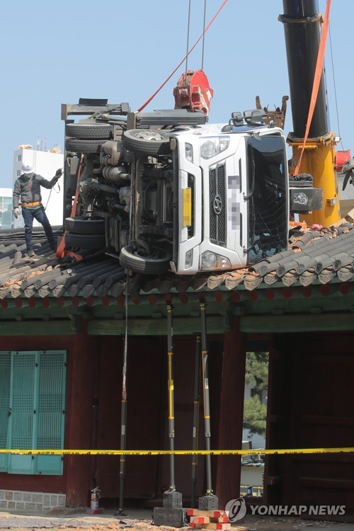 Truck on roof of shrine gate