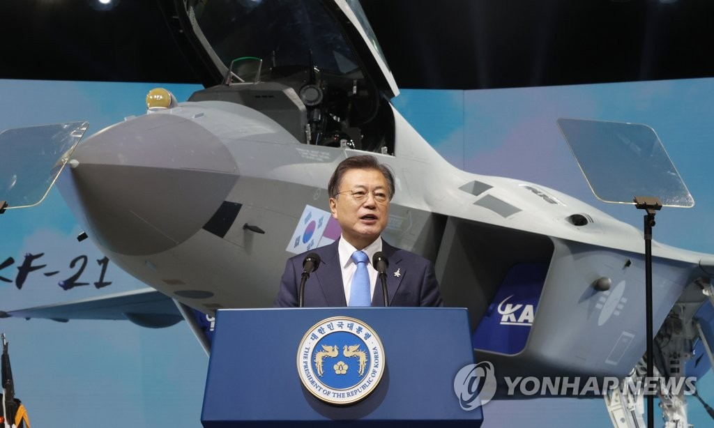 President Moon Jae-in speaks during a ceremony at the Korea Aerospace Industries Co. facility in Sacheon, South Gyeongsang Province, southeastern South Korea, on April 9, 2021, to unveil the country's first prototype of the next-generation KF-X fighter, officially named the KF-21 Boramae. (Yonhap)