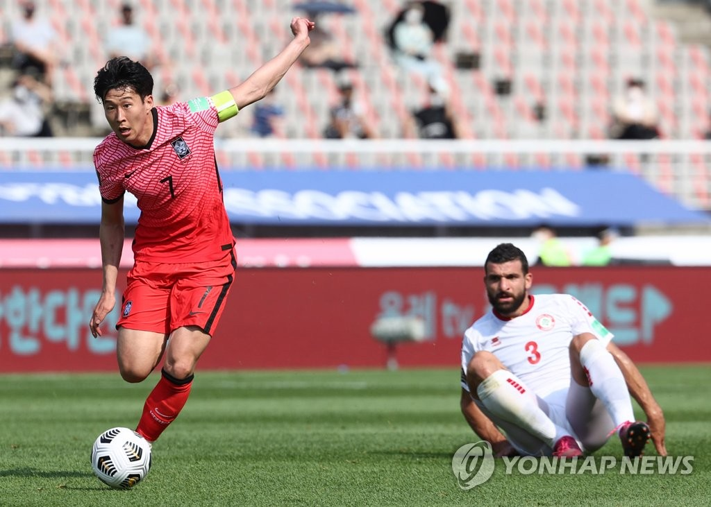 Son Heung-min of South Korea (L) dribbles past Maher Sabra of Lebanon during the teams' Group H match in the second round of the Asian qualification for the 2022 FIFA World Cup at Goyang Stadium in Goyang, Gyeonggi Province, on June 13, 2021. (Yonhap)