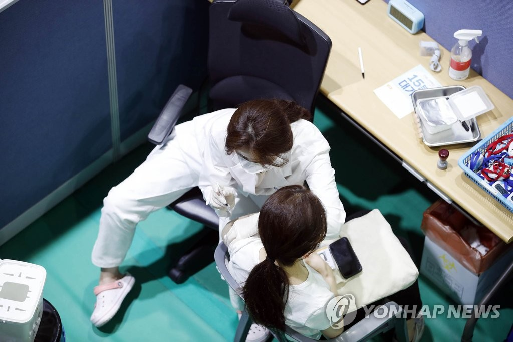 A medical worker vaccinates a citizen at a makeshift clinic in Gwangju, 330 kilometers south of Seoul, on July 16, 2021, in this photo released by the Buk Ward office of the city. (PHOTO NOT FOR SALE) (Yonhap)